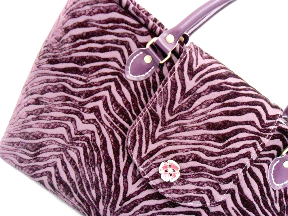 Purple velvet handbag