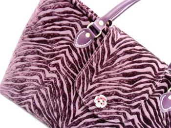 Purple velvet handbag