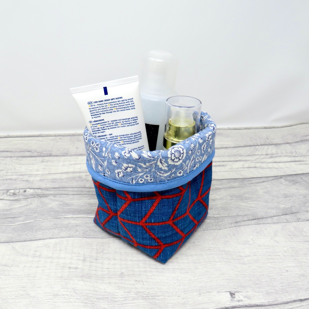 Small blue fabric storage bin