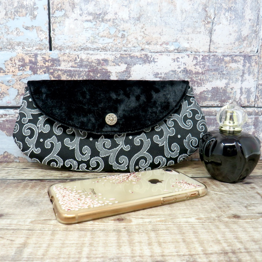 Mini clutch in black and silver