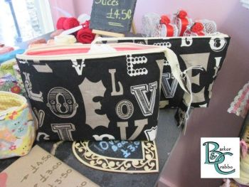 Wide mouth zipped pouch - Black with mono text LOVE lined with coral