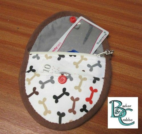 purse with oval flap - white bright bones pattern lined with grey