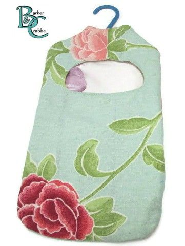 Old fashioned washing line peg bag - soft turquoise with big flowers
