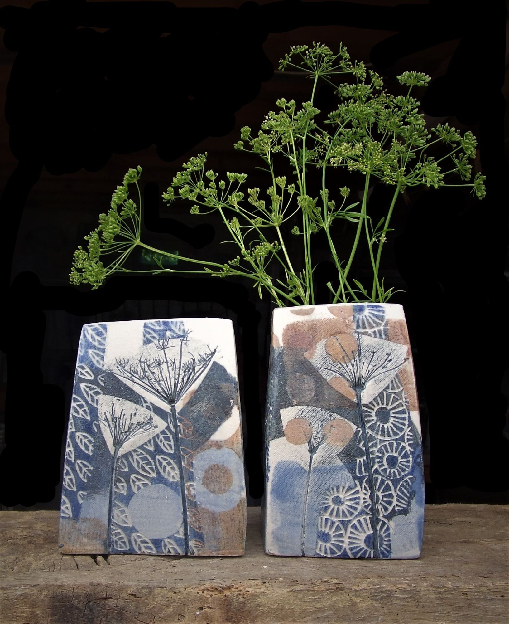 Square vases with flowers, blue and gold