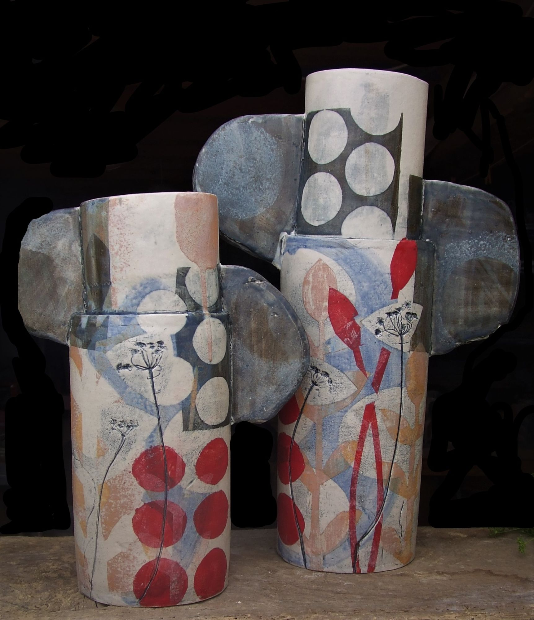 2 large red totems with spots