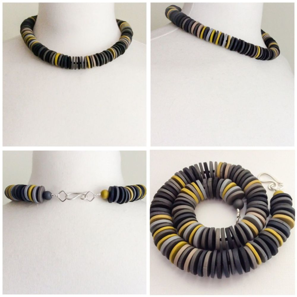 Large disc necklace grey and mustard collage