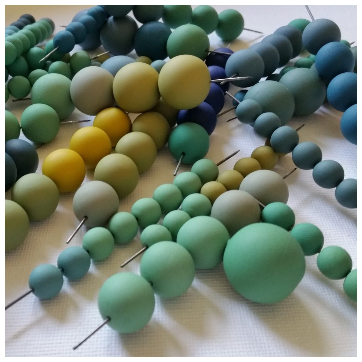 Handmade polymer clay round beads by Clare Lloyd