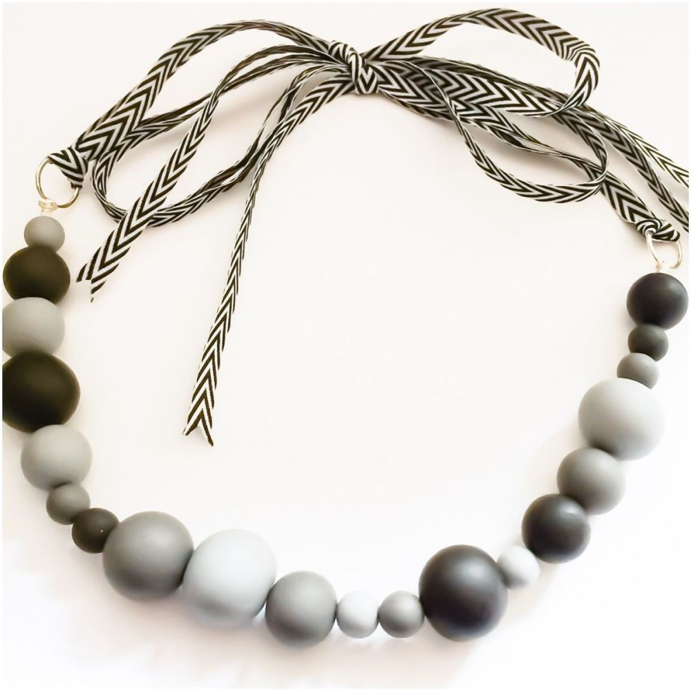 Random bead necklace grey and black close up