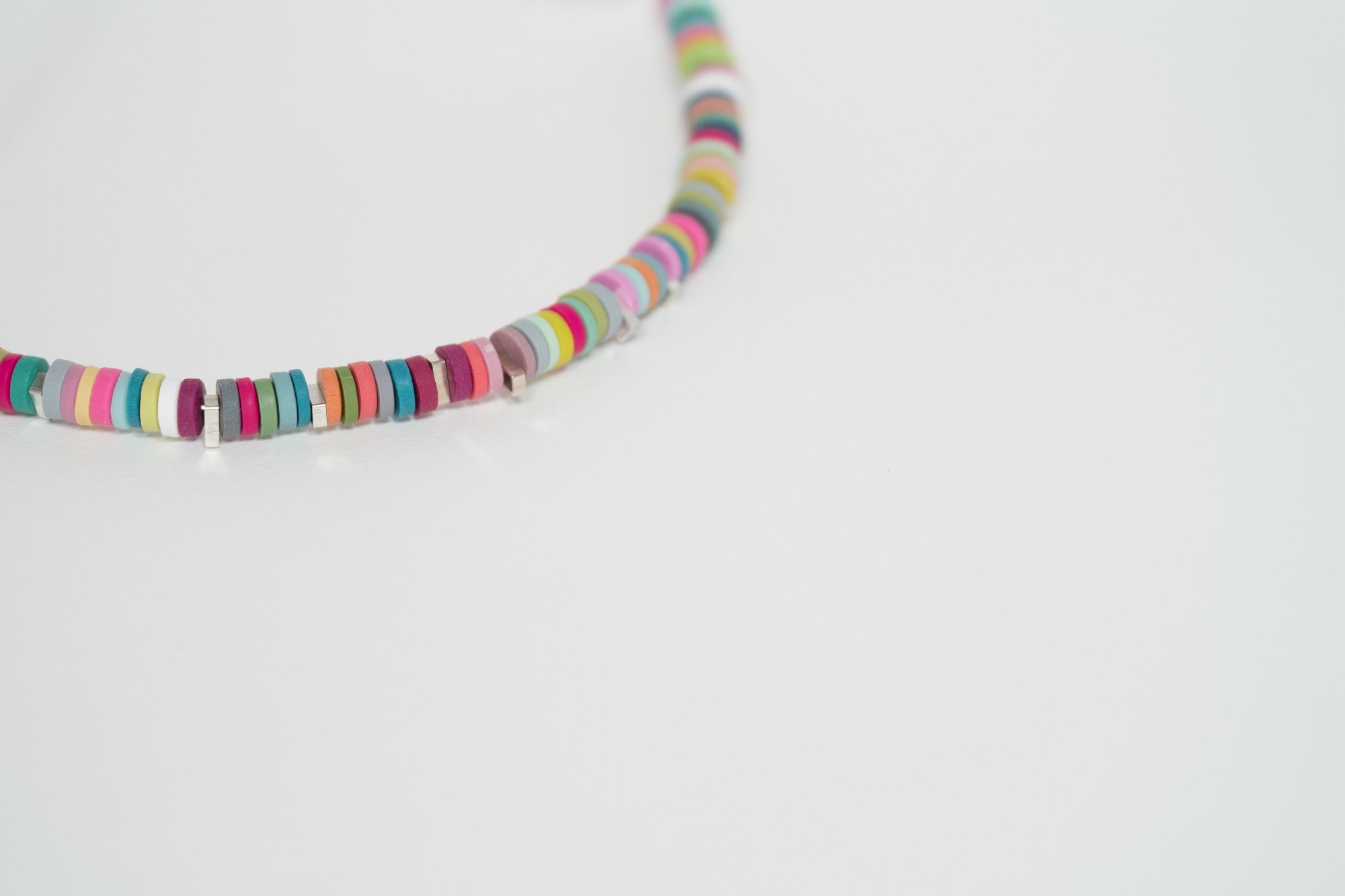 Multi coloured tiny disc polymer clay necklace by Colour Designs Jewellery