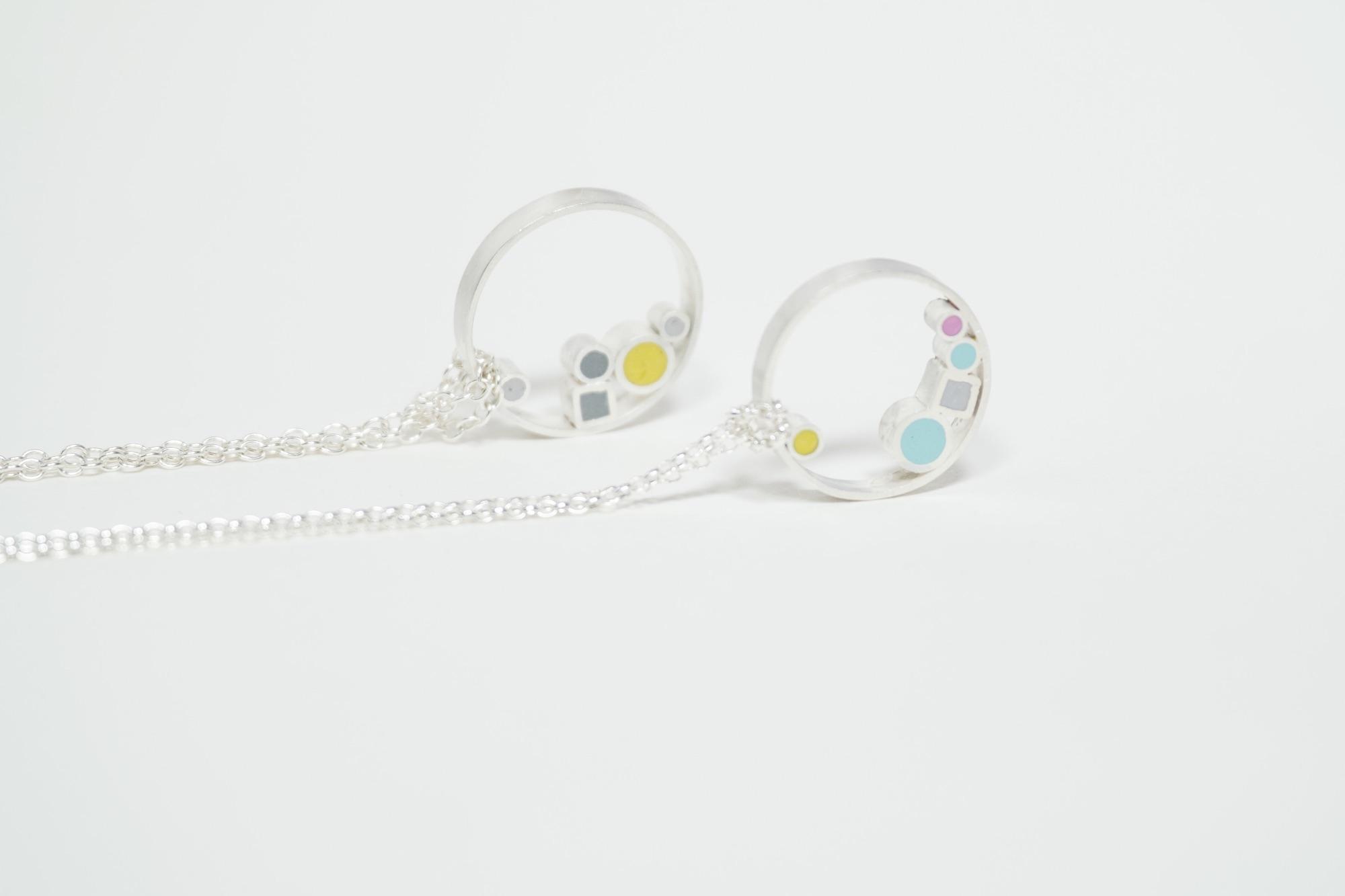 Circle pendant necklaces by Colour Designs