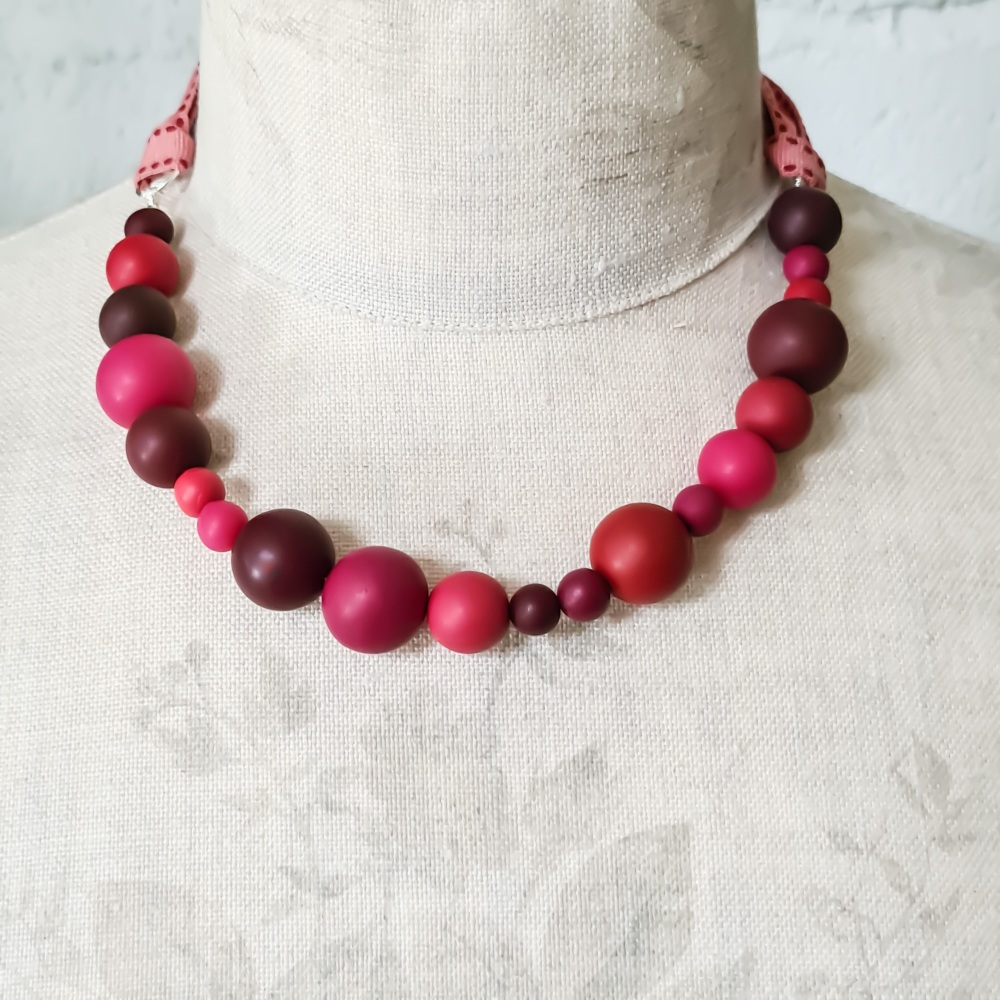 Random Bead Necklace with Ribbon Ties in Reds and Pinks