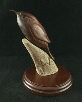 Treecreeper on carved stump