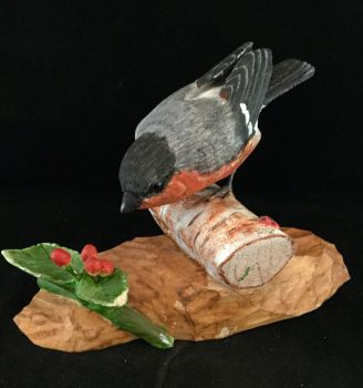 Bullfinch on carved log