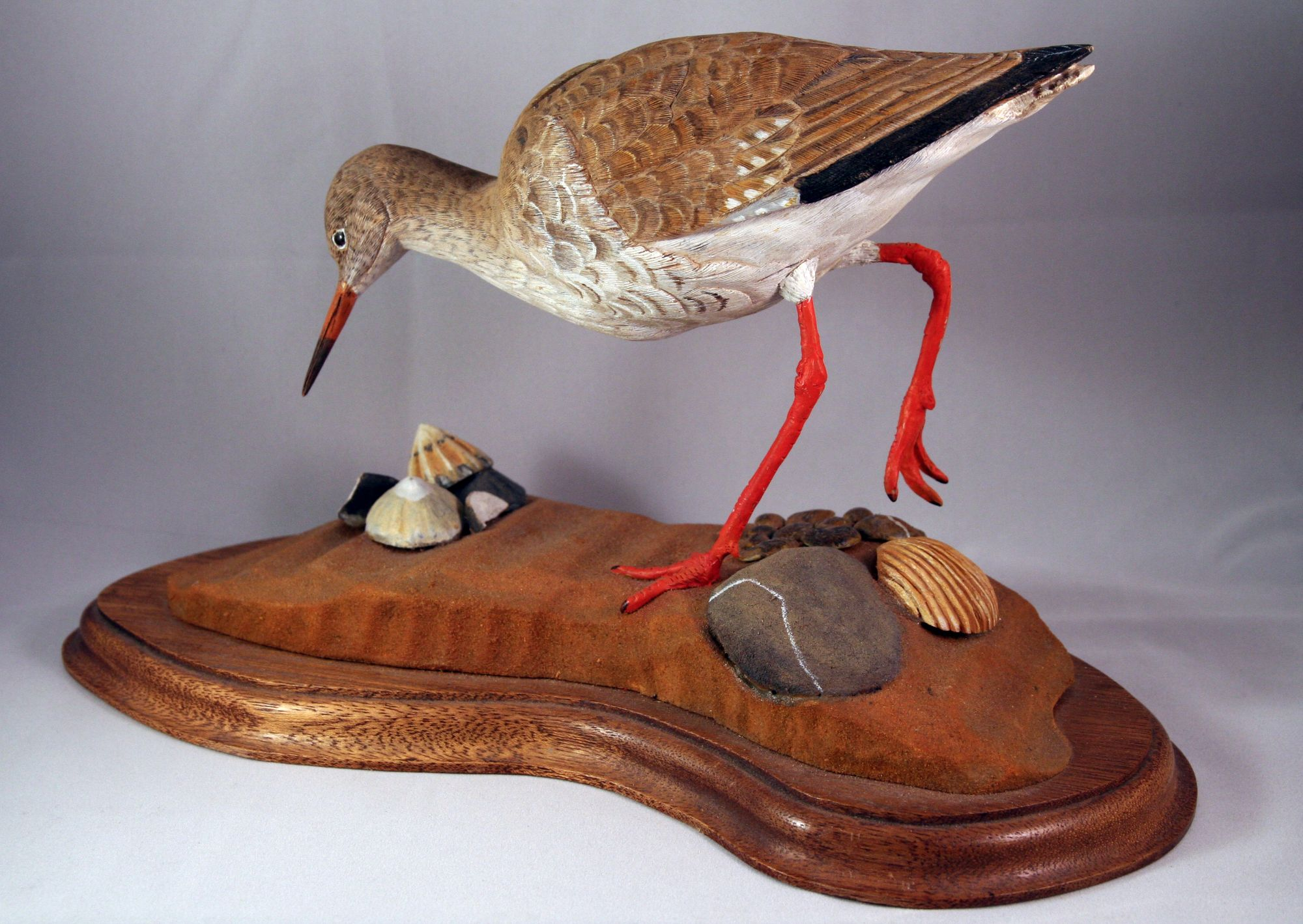 Redshank with carved pebbles and shells