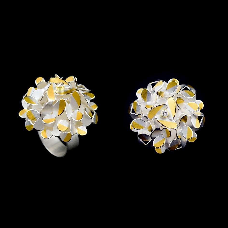 Circular ovals flower ring with diamond