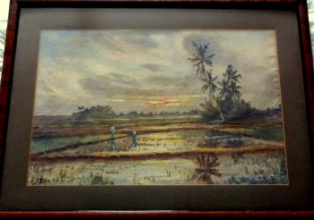 In the Paddy Fields at Sunset, Malaya, watercolour, signed Adie, c1920. Framed.