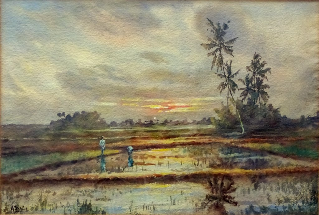 In the paddy fields at sunset, Malaya, watercolour, signed Adie, c1920.
