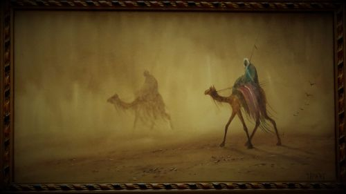 Riders in Desert Sandstorm, watercolour and gouache, signed DH Pinder. c192