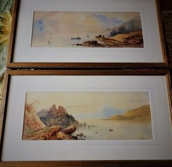 A Pair, Highland loch scenes with fishing boats, figures and cattle with misty mountains. Watercolour signed Edwin Earp, c1920.