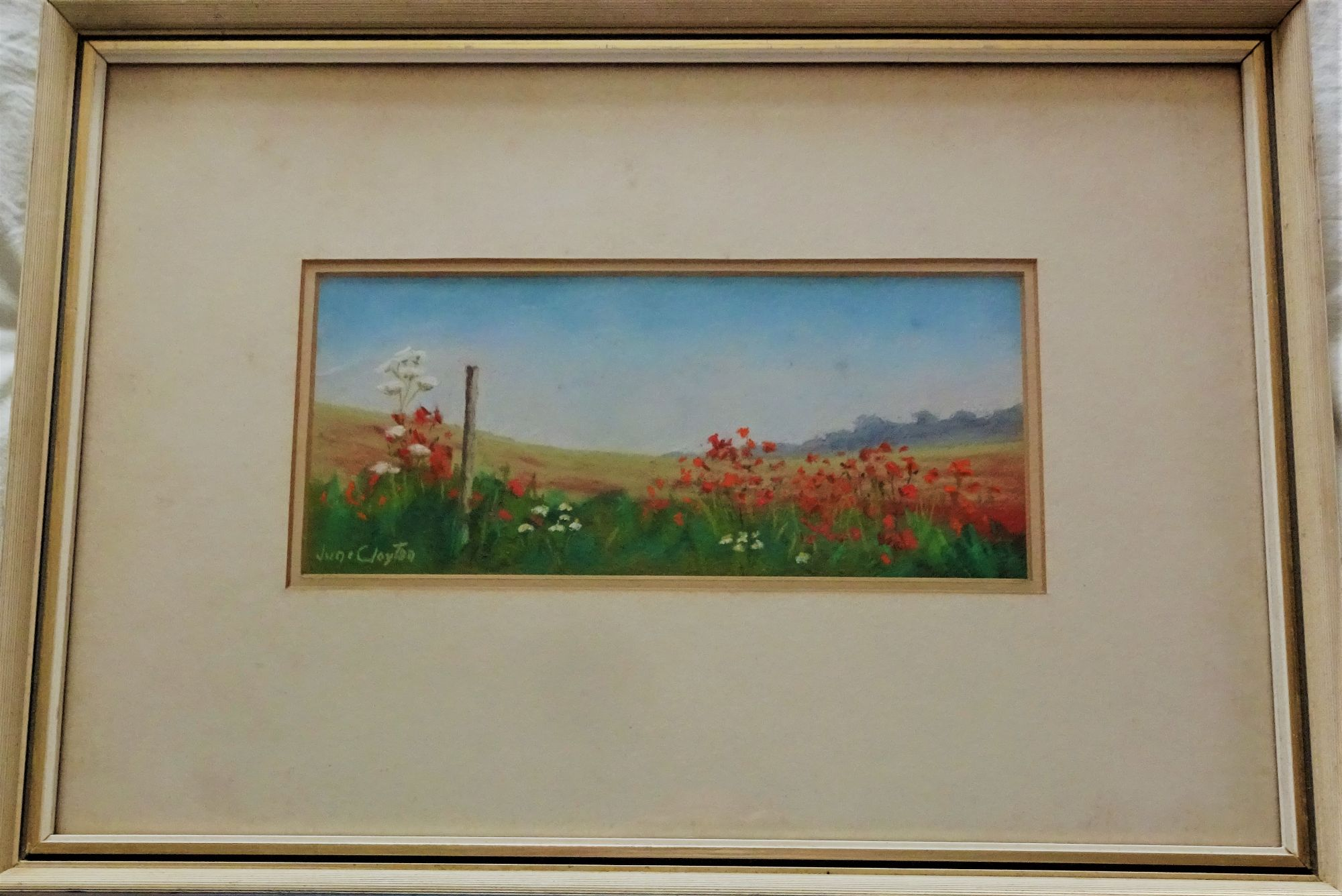 June Clayton, Wild Poppies landscape, gouache, signed titled and dated 1985.