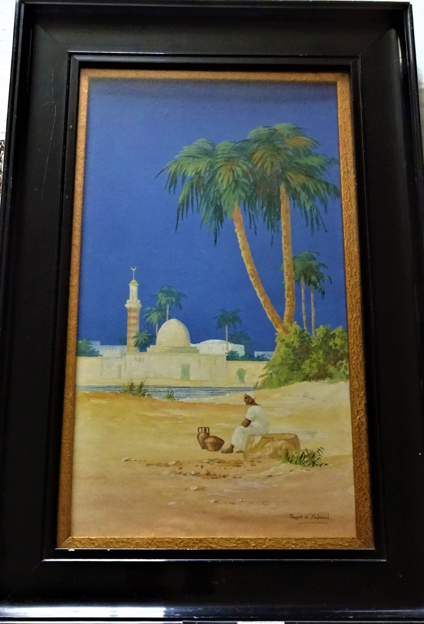 Taking a Rest opposite the Mosque, gouache on paper, signed Hassan el Yashmid, c1900. Framed.