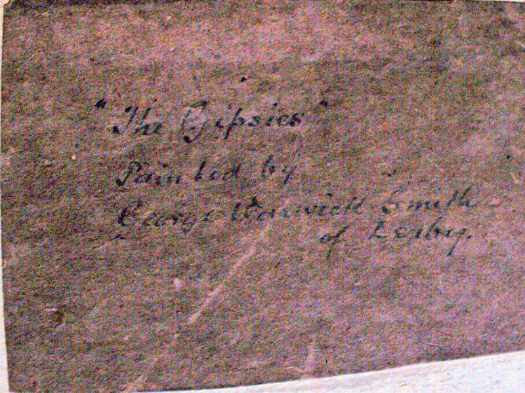 The attached label with handscript.