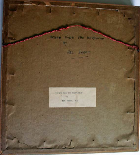 Back of the frame, sealed with label and script.