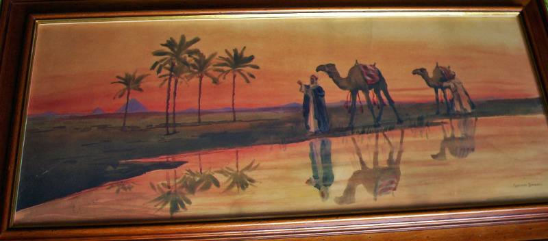 Figures leading camels past flooded river, watercolour.