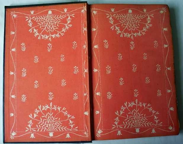 Decorated front paste-down and front e/p on tangerine.