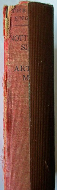 The spine showing tape.