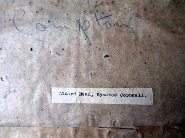 Title label and handscript on back of the frame.