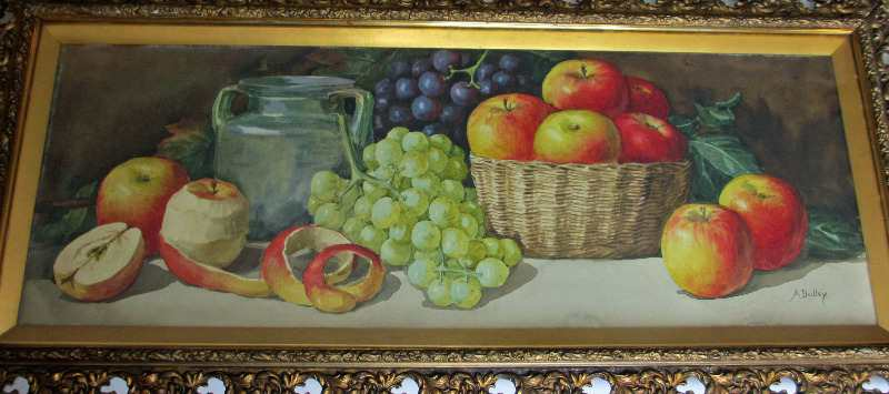 Still-life study of apples and grapes.