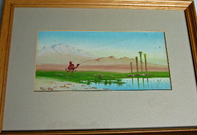 Man on camel in Egyptian desert near ruins, gouache on paper, signed Felix