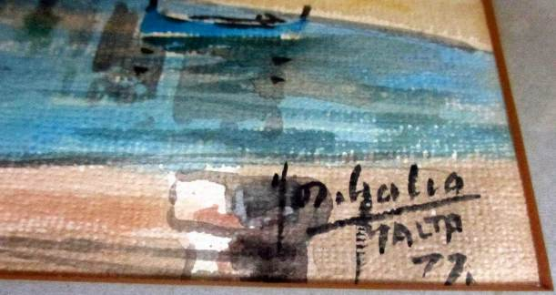 The artist's signature in detail.