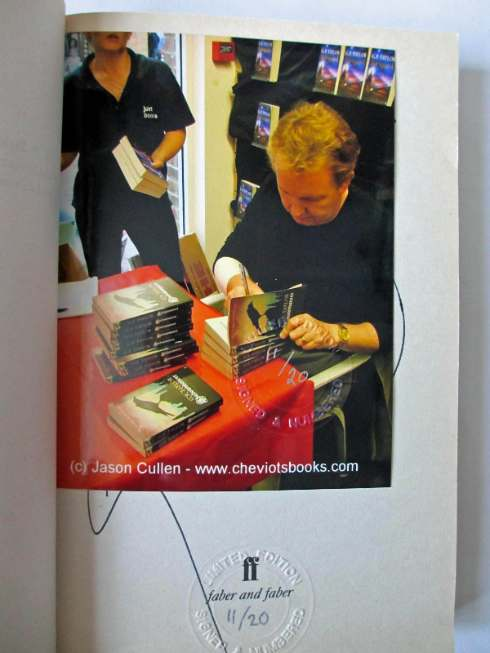 Colour photocard of the author signing the 20 limited editions.