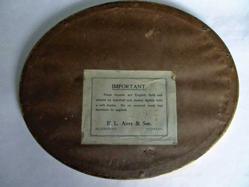 The back of the oval frame with label attached.