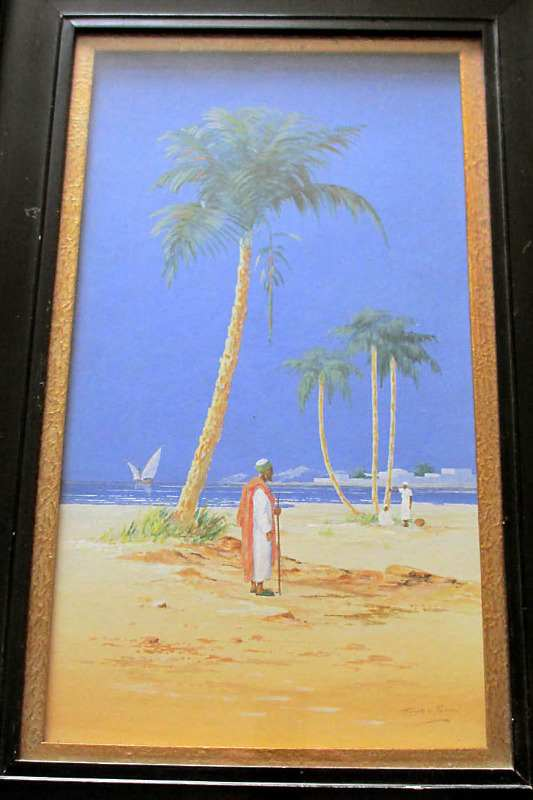 Figures by the River Nile, watercolour on paper, signed Hass El Yashmid c1900.