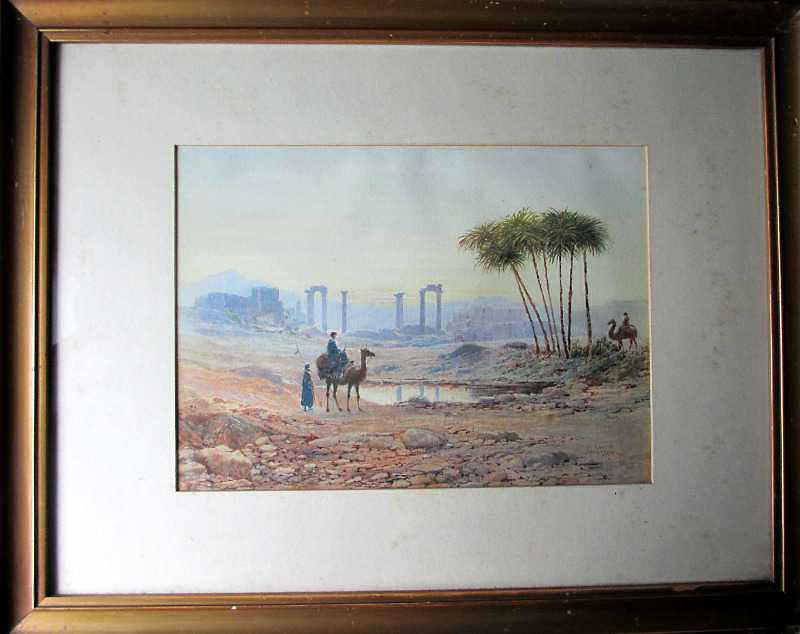 A North African Oasis with figures and ruins signed by John W Hepple 1915.