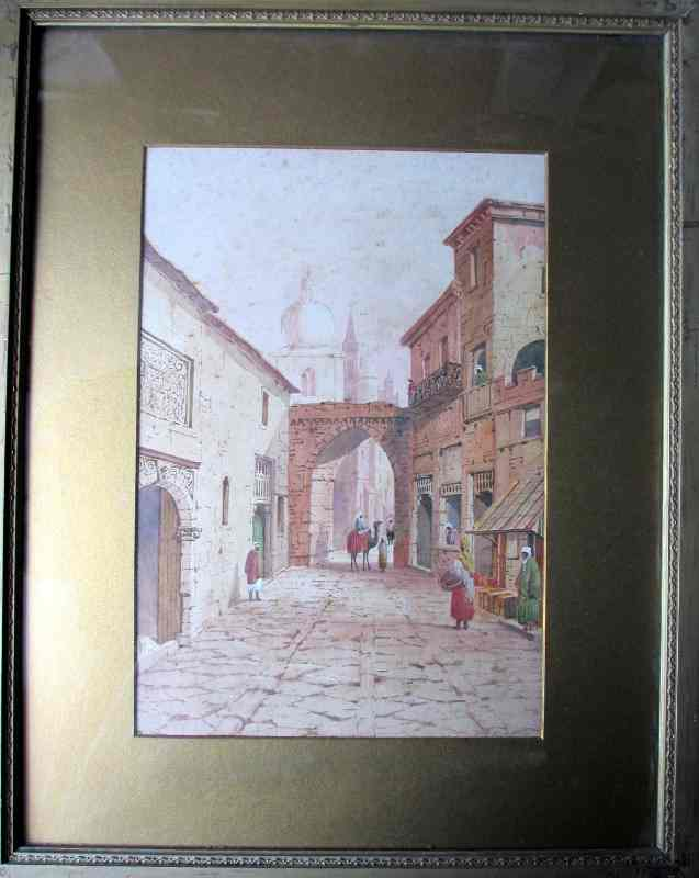 An Arabian Street Scene with Figures and Camel, watercolour on paper, signed A. Lewis, 1901. Framed and glazed.