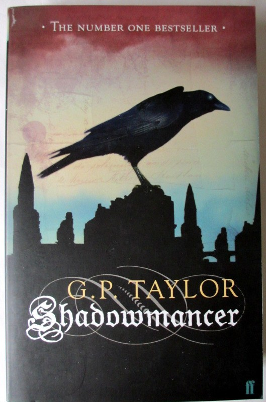 Shadowmancer by G.P. Taylor. Limited Edition 8/20, signed by the author 2003. With colourcard of author signing.