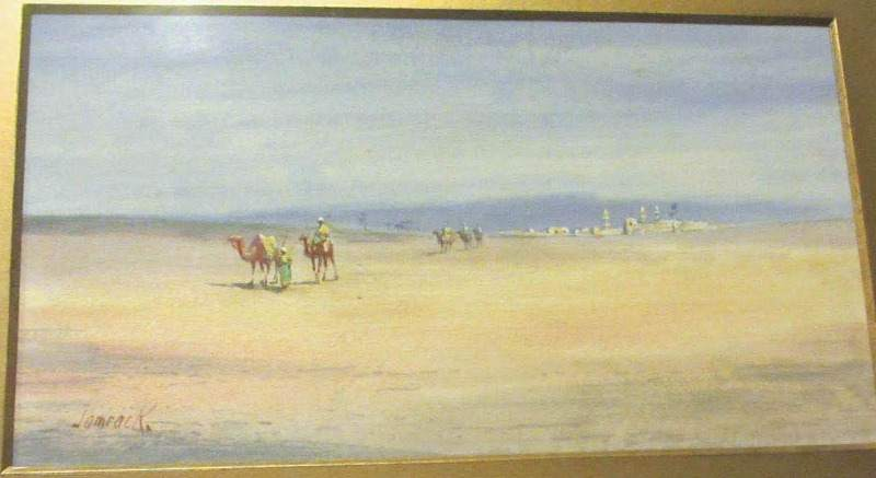 Camel train leaving the desert town, signed Jamrack c1880.