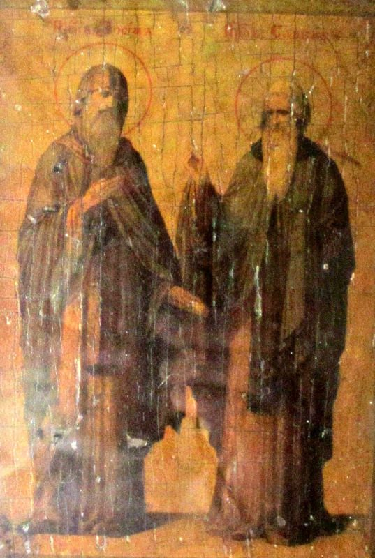 Iconic Study of Two Saints, oil on vellum, laid to board,19th C Eastern Orthodox School, c1885. With light to view detail.