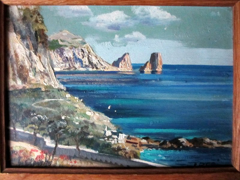 Coastal Scene of Capri with I. Faraglioni in background.