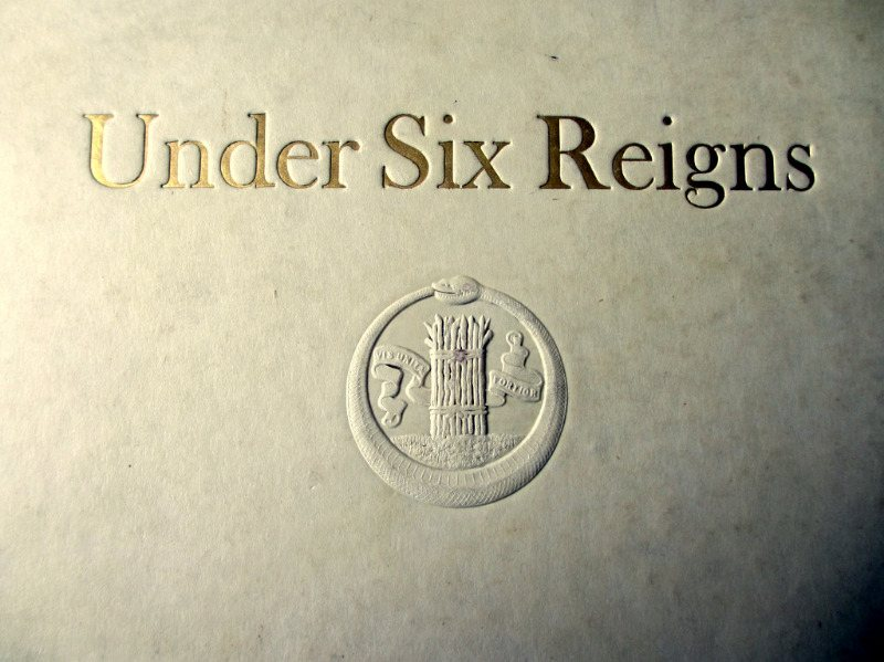 Under Six Reigns, The House of Waterlow by John Boon 1925. Detail. Front board emblem.