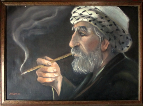 An Afghan smoking cigarette, oil on khadi, signed Hashim 89. 1989.