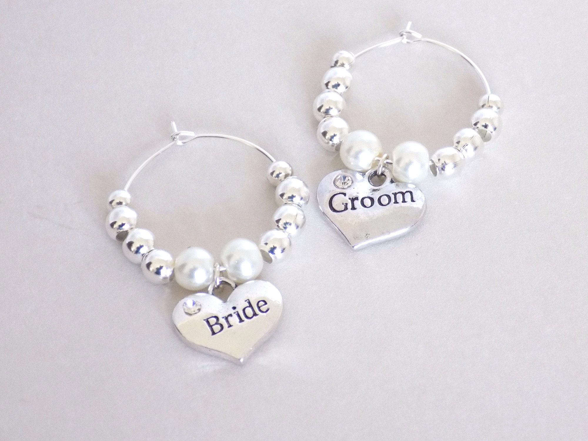 white bride and groom wine charms