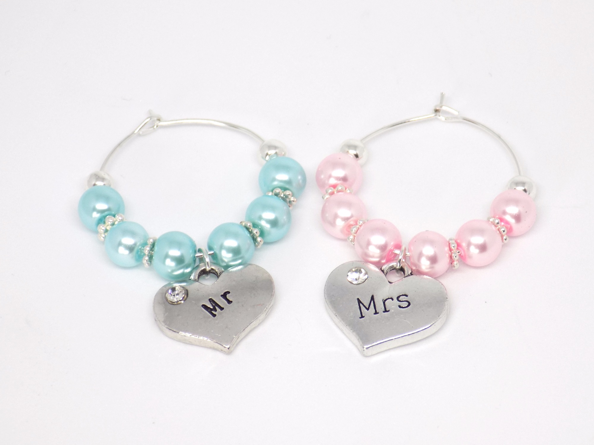 pink and blue wine charms