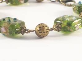 close up of green lampwork bracelet
