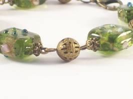 close up of green lampwork bracelet