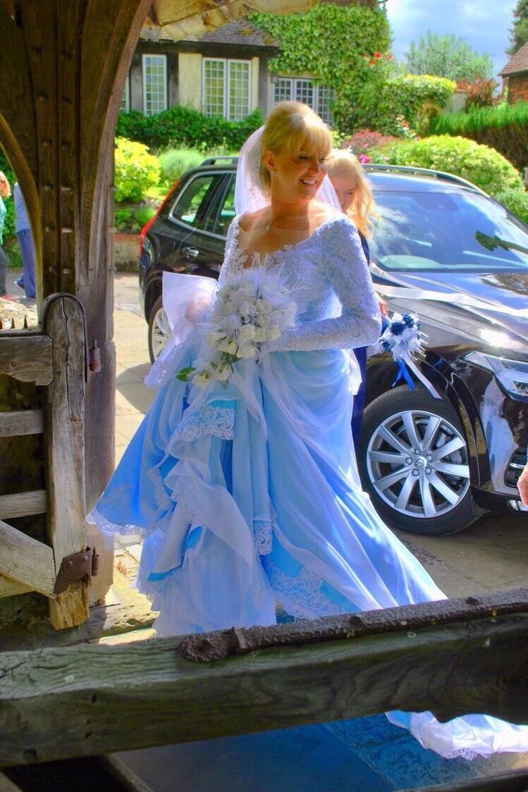 blue long sleeved lace wedding gown